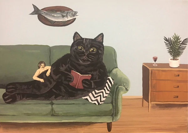 cat on couch reading art